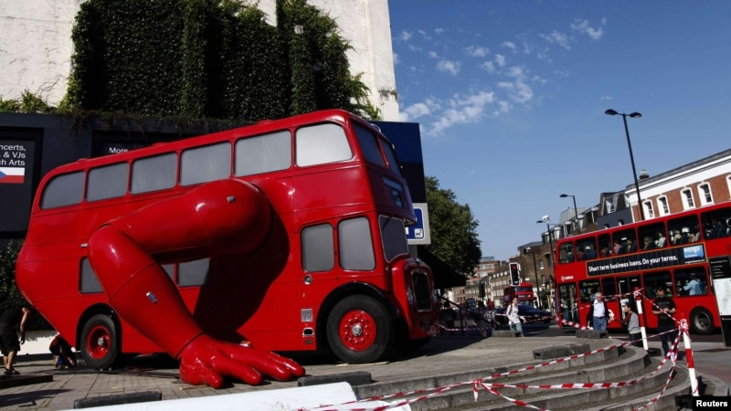 A London bus that has been transformed into a robotic sculpture by Czech artist David Cerny is assembled in front of the Czech Olympic headquarters in London. Credit: Marika Kochiashvili/REUTERS