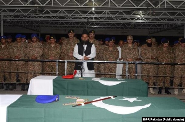 FILE: Pakistani soldiers and officer offer funeral prayers for colleagues killed in North Waziristan.
