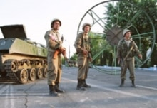 Uzbekistan – After Andijon – Uzbek soldiers on the streets of Andijon a day after the bloodshed, 14 May 2005. (Size: 220x155)