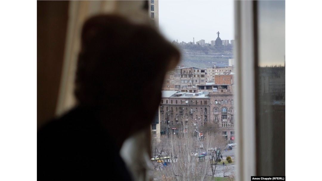 Muradian looks from her bedroom window toward the Mother Armenia monument.