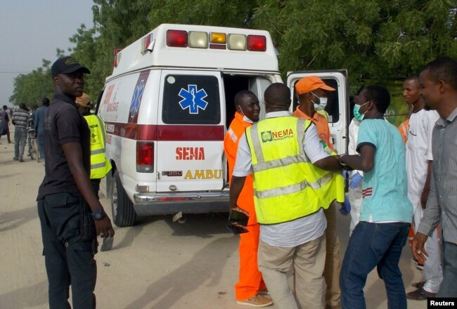 FILE - Rescue workers are seen at the site of an attack by Boko Haram militants in the northeast city of Maiduguri, Nigeria, April 27, 2018.