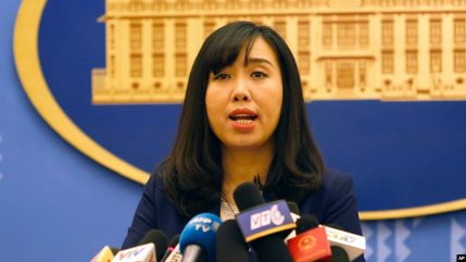 FILE - Vietnamese Foreign Ministry spokeswoman Le Thi Thu Hang speaks to reporters during a regular press briefing in Hanoi, Vietnam, Aug. 3, 2017.