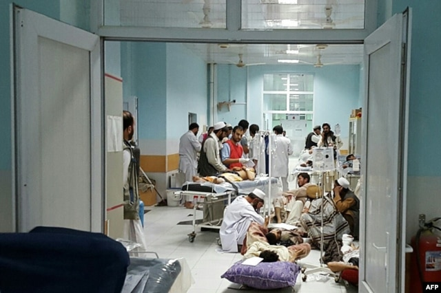 In this undated photograph released by Doctors Without Borders (MSF) on October 3, 2015, Afghan MSF medical personnel treat civilians injured following an offensive against Taliban militants by Afghan and coalition forces at the MSF hospital in Kunduz.