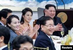 FILE - North Korean leader Kim Jong Un applauds with his wife Ri Sol Ju and sister Kim Yo Jong at the truce village of Panmunjom inside the demilitarized zone separating the two Koreas, South Korea, April 27, 2018.