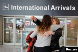 FILE - Mahnaz Kanani Zadeh, right, is greeted by her niece Negin after traveling to the U.S. from Iran following a federal court's temporary stay of U.S. President Donald Trump's executive order travel ban, at Logan Airport in Boston, Massachusetts, Feb.