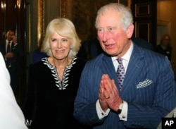 FILE - Britain's Prince Charles and Camilla, Duchess of Cornwall attend the annual Commonwealth day reception at Marlborough House, the home of the Commonwealth Secretariat, in London, March 9, 2020.