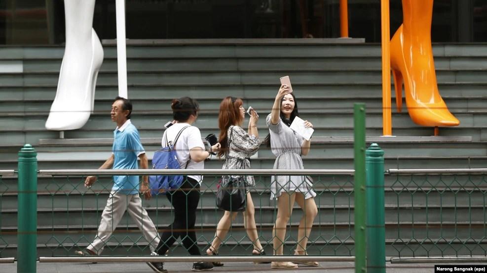 Tourists at a shopping center in Bangkok, Thailand, June 27, 2016.