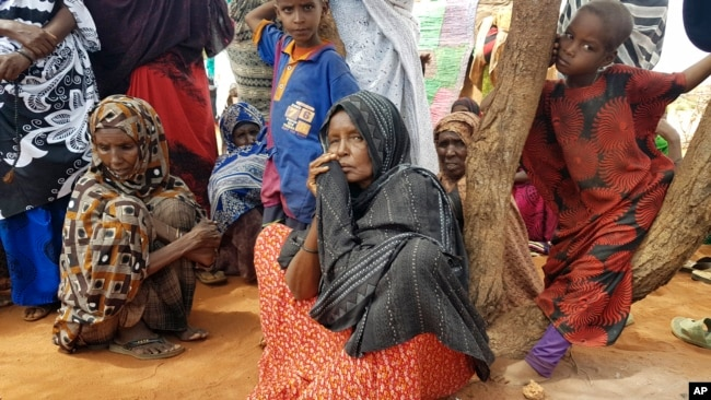 FILE - A mother of 12 (center), who was displaced from her village due to drought, sits among a group of women in the town of Werder, in Ethiopia's Somali region, June 9, 2017.