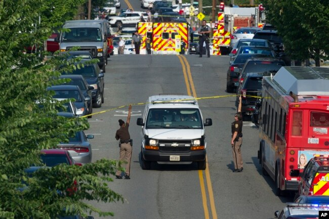 Police and emergency personnel are seen near the scene where House Majority Whip Steve Scalise of La. was shot during a Congressional baseball practice in Alexandria, Virginia, June 14, 2017.