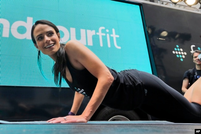 You don't equipment or even much floor space to do some pushups. In this photo, actress Jordana Brewster leads a workout in front of the New York Stock Exchange. (2015 AP Photo)