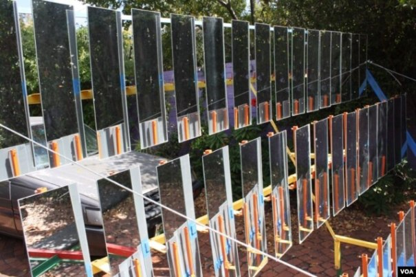 The South African designed Sol-4 solar thermal cooker consists of an array of 48 mirrors that reflect the sun and generate heat. (Darren Taylor for VOA)