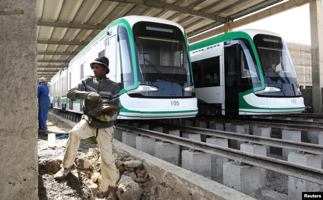 FILE - A worker works on the electrified light rail transit construction site in Ethiopia&rsqo;s capital, Addis Ababa, Dec. 16, 2014. The project was built by China Railway Engineering Corporation (CREC) and mostly financed through a loan from China's Exim Bank.
