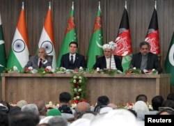 Afghan President Ashraf Ghani (2nd R), Pakistani Prime Minister Shahid Khaqan Abbasi (R), Turkmen President Kurbanguly Berdymukhamedov (2nd L) and India's Minister of State for External Affairs M.J. Akbar (L) attend the inauguration ceremony of TAPI pipeline construction work, in Herat, Afghanistan, Feb. 23, 2018.