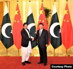 Pakistani Prime Minister Imran Khan with Chinese President Xi Jinping ahead of their meeting on November 2, 2018 in Beijing, China. (Office of the Prime Minister of Pakistan about Ayaz Gul)