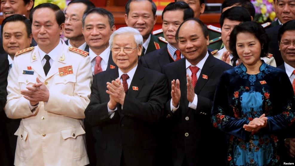 (Từ trái sang) Chủ tịch nước Trần Đại Quang, Tổng Bí thư Nguyễn Phú Trọng, Thủ tướng Nguyễn Xuân Phúc và Chủ tịch Quốc hội Nguyễn Thị Kim Ngân tại Đại hội XII, ngày 28/1/2016.