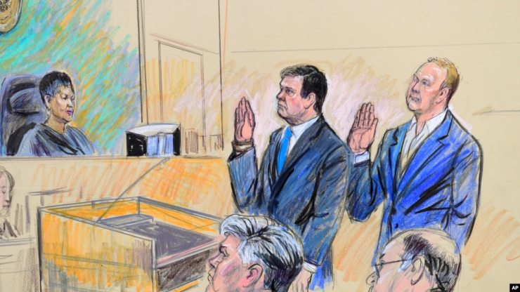 FILE - A court artist's drawing shows President Donald Trump's former campaign chairman, Paul Manafort, center standing, and Manafort's business associate, Rick Gates, in federal court in Washington, Oct. 30, 2017, before U.S. Magistrate Judge Deborah A. Robinson.