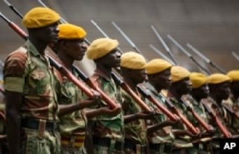 FILE: Members of the Zimbabwean military parade during a dress rehearsal for Friday's presidential inauguration of Emmerson Mnangagwa, at the National Sports Stadium in Harare, Zimbabwe, Nov. 23, 2017.