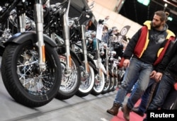 FILE - Harley-Davidson bikes are lined up at a bike fair in Hamburg, Germany, Feb. 24, 2017. The bikes, along with other iconic U.S. products, could be hit with retaliatory tariffs.