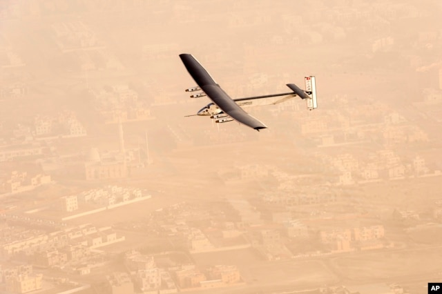 """FILE - In this photo released by Solar Impulse, """"Solar Impulse 2"""", a solar-powered airplane flies after taking off from Al-Bateen Executive Airport in Abu Dhabi, United Arab Emirates, March 9, 2015."""