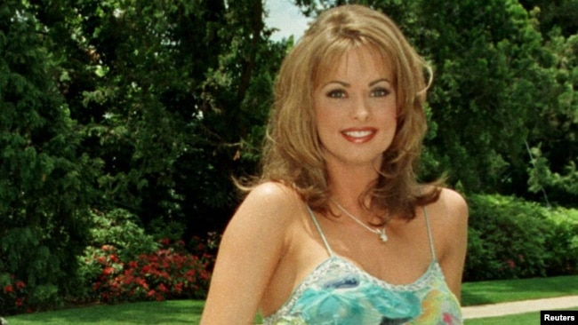 FILE - Then-newly named Playboy Playmate of the Year Karen McDougal poses on the grounds of the Playboy Mansion in Beverly Hills, California, May 29, 1998.