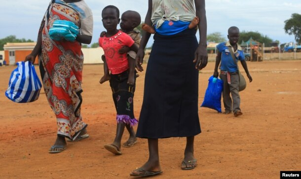FILE - A South Sudan refugee family arrives at the UNHCR managed refugees reception point at Elegu, within Amuru district of the northern region near the South Sudan-Uganda border, Aug. 20, 2016.