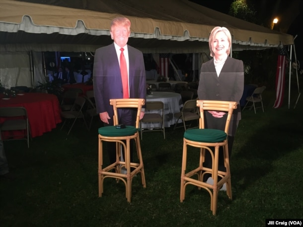 Cardboard cutouts of both candidates on display during a breakfast at the home of U.S. ambassador in Nairobi, Kenya.