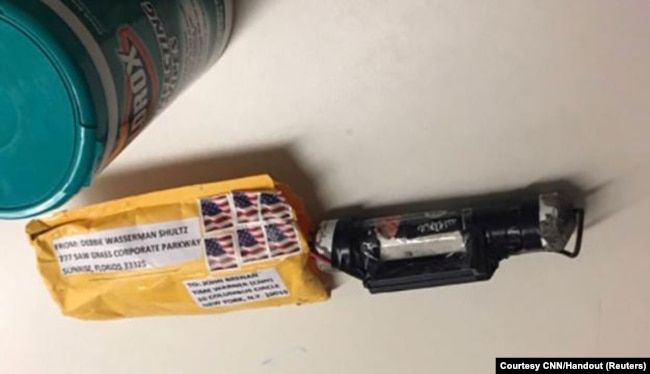 "A package containing a ""live explosive device"" according to police, received at the Time Warner Center which houses the CNN New York bureau, in New York City, is shown in this handout picture provided Oct.24, 2018."