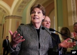 FILE - Sen. Jeanne Shaheen speaks to reporters on Capitol Hill in Washington, Oct. 24, 2017.