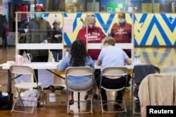 Voters prepare to cast their ballot in the Democratic primary in Philadelphia, Pennsylvania, U.S., June 2, 2020.