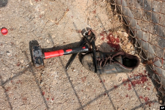 Image released by the Spanish Guardia Civil on Aug. 22, 2018 shows items used by alleged migrants after they stormed a fence to enter the Spanish enclave of Ceuta, Spain.