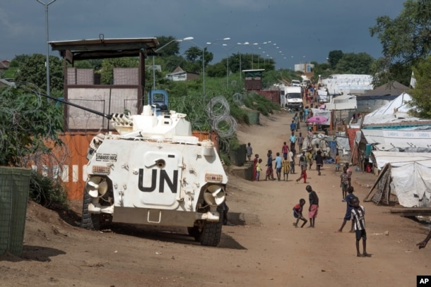 FILE---In this file photo taken Monday, July 25, 2016, A UN armoured personnel vehicle stand in a refugee camp in Juba, South Sudan.
