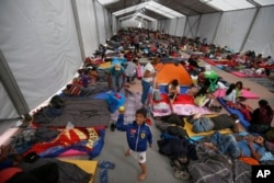 Central American migrants, part of a caravan hoping to reach the U.S., get settled in a shelter at the Jesus Martinez stadium, in Mexico City, Nov. 5, 2018.