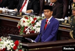 FILE - Indonesian President Joko Widodo deliver a speech in front of parliament members at the parliament building in Jakarta, Indonesia, Aug. 16, 2018.