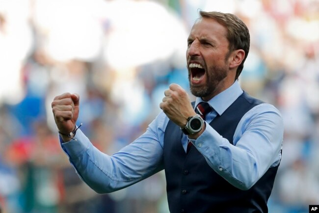 England head coach Gareth Southgate celebrates his team's 6-1 victory at the end of the group G match between England and Panama at the 2018 soccer World Cup at the Nizhny Novgorod Stadium in Nizhny Novgorod , Russia, Sunday, June 24, 2018.