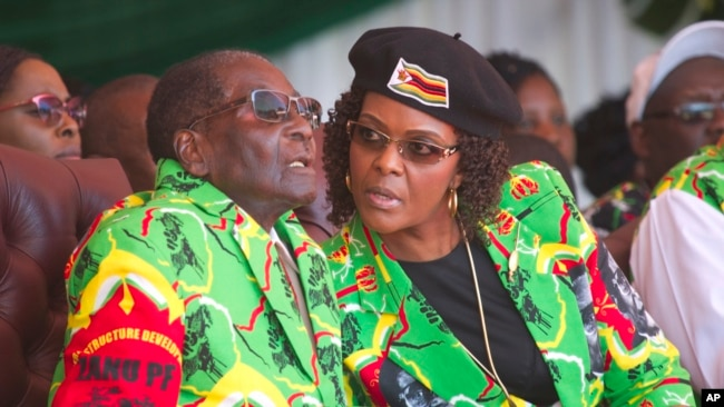 FILE - Zimbabwean President Robert Mugabe and his wife Grace follow proceedings during a youth rally in Marondera about 100 kilometers east of Harare, June, 2, 2017.