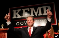 Georgia Republican gubernatorial candidate Brian Kemp gives a thumbs-up to supporters in Athens, Ga., Nov. 7, 2018.