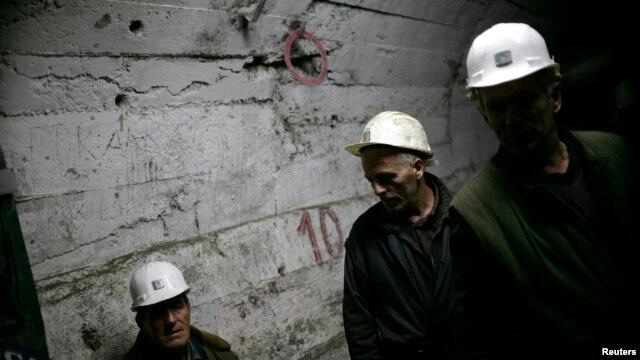 FILE - Miners walk in underground tunnel in Trepca mines, Mitrovica, Nov. 2008.