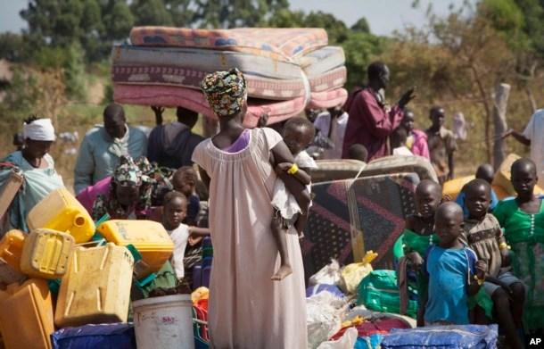 FILE - Refugees arrive in Uganda after fleeing violence in South Sudan, Jan. 6 2014.