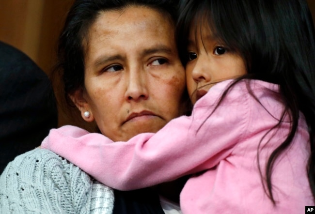 Jeanette Vizguerra, left, a Mexican woman seeking to avoid deportation from the United States, cradles her 6-year-old daughter, Zuri, during a news conference in a church in which she and her children have taken refuge, Feb. 15, 2017, in Denver.