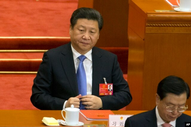 FILE - Chinese President Xi Jinping attends the closing session of the annual National People's Congress in Beijing's Great Hall of the People, March 16, 2016.