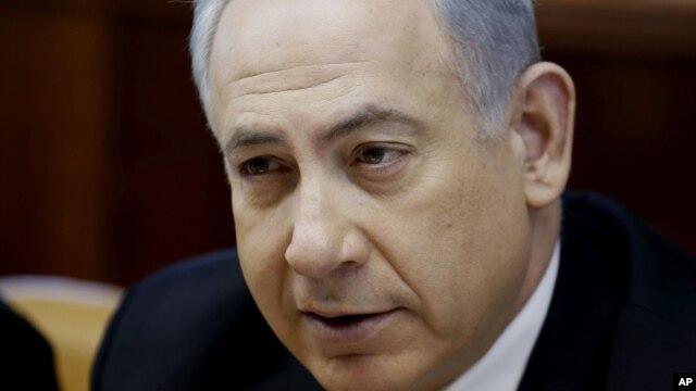 Israeli Prime Minister Benjamin Netanyahu chairs a weekly cabinet meeting at his office in Jerusalem, Dec. 22, 2013.