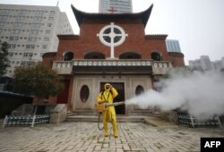 A worker disinfects the Hankou Salvation Church in Wuhan, in China's central Hubei province on March 6, 2020.