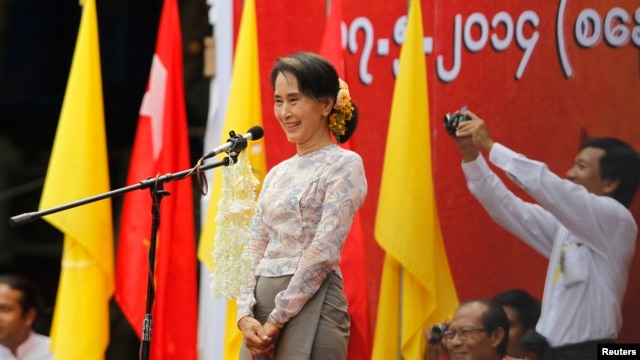 FILE - Myanmar's pro-democracy leader Aung San Suu Kyi delivers a speech at a rally in Boseinman Stadium in Yangon.