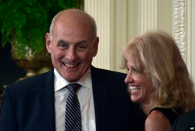 FILE - White House chief of staff John Kelly, left, and White House counselor Kellyanne Conway laugh before the start of a news conference.