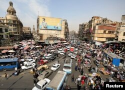 FILE - A general view of a street in downtown Cairo, Egypt, March 9, 2017.