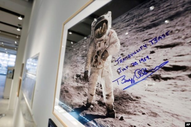 """A print of astronaut Neil Armstrong's photograph of fellow Apollo 11 astronaut """"Buzz"""" Aldrin standing on the moon, to be offered at auction at Sotheby's, is displayed in New York, July 13, 2017."""