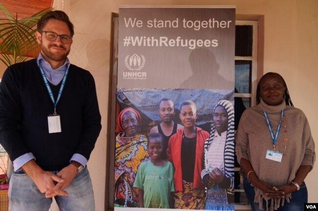 Sebastian Herwig, left, of the associate resettlement officer for the UNHCR in Malawi, poses with UHCR Protection Officer Gloria Muleba Mukama outside the UNHCR offices in the capital Lilongwe. (L. Masina/VOA)