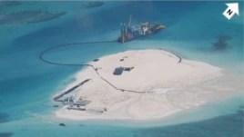 Trung Quốc bị tố cáo lấp biển để lấy đất trên một hòn đảo san hô đang có tranh chấp chủ quyền ở Biển Đông.