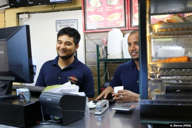 Employees tend to customers at Aladdin Sweets & Cafe in Banglatown, Hamtramck, Michigan.