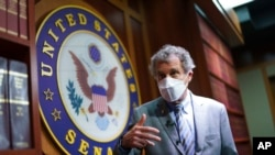 Sen. Sherrod Brown, D-Ohio, speaks to reporters at the Capitol on September 23, 2021 in Washington.